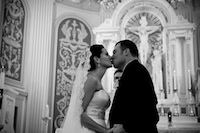 married couple kissing in church